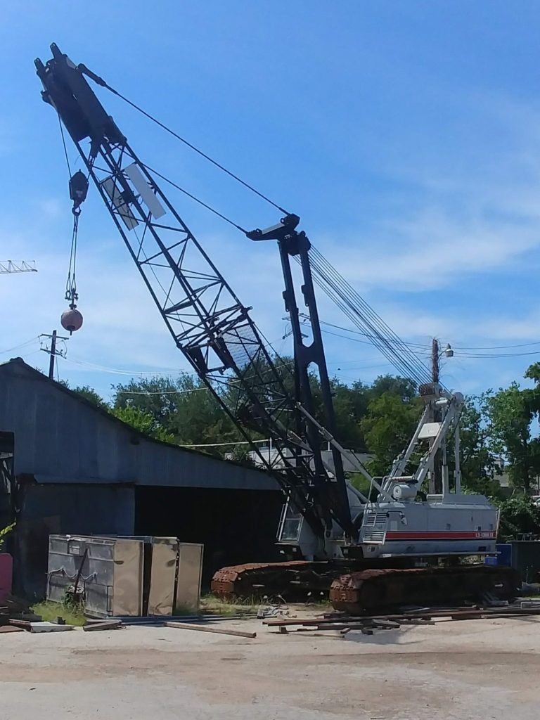 Up close view of a grey crane provided by ATX Cranes.